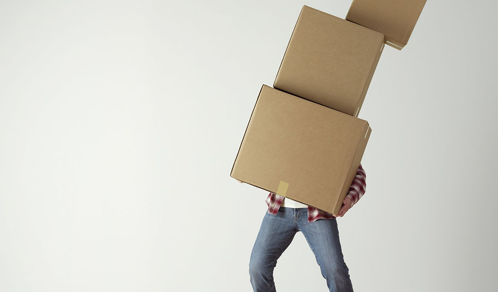 man holding 3 boxes