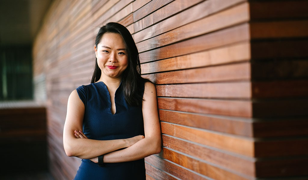 business woman by wooden wall