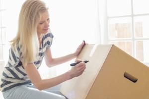 women writing on boxes