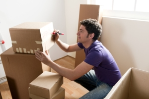 man writing on boxes